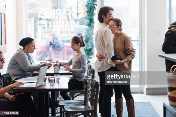 """people spending leisure time in a local coffee shop. - """"martine doucet"""" or martinedoucet stock pictures, royalty-free photos & images"""