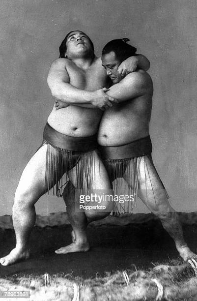 circa 1900's Two wrestlers weighing 35 stone grappling with each other in the prize ring