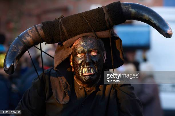 People sporting horns on their heads and grease on their faces perform as 'Diablos de Luzon' during the carnaval in Luzon, near Guadalajara on March...
