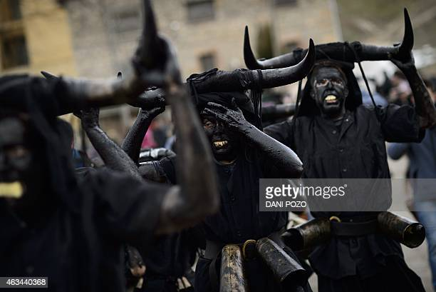 People sporting horns on their heads and grease on their faces perform as Diablos de Luzon during the carnaval in Luzon near Guadalajara on February...