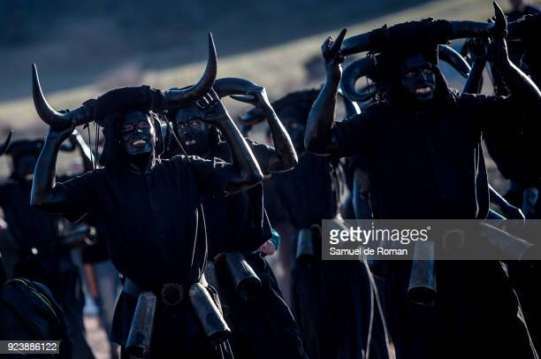 People sporting horns on their heads and grease on their faces perform as 'Diablos de Luzon' during the carnaval in Luzon near Guadalajara on...