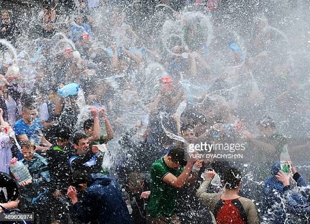 People spray water on one another in the western Ukrainian city of Lviv on April 13 as they celebrate Clean Monday a Ukrainian Christian tradition...