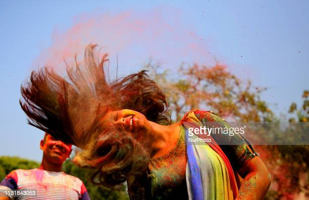 People spread abir celebrating Dol Purnima festival at Dhakeshwari national temple in Dhaka Bangladesh on 21 March 2019