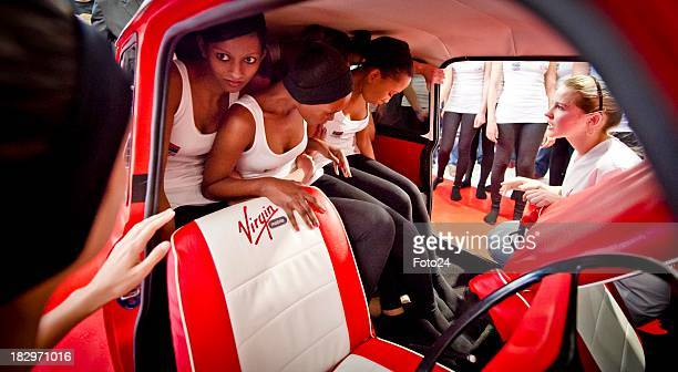 People squeezing into a Mini Cooper on October 10 in Johannesburg South Africa Virgin Mobile South Africa has successfully achieved a Guinness World...