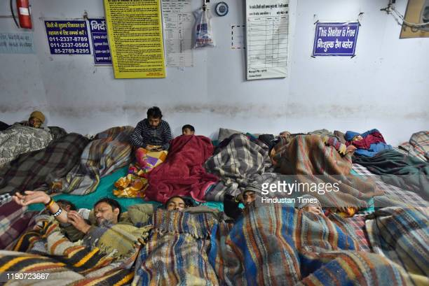 People ssleep in a night shelter on a cold winter night at Jama Masjid on December 28 2019 in New Delhi India With the minimum temperature plummeting...