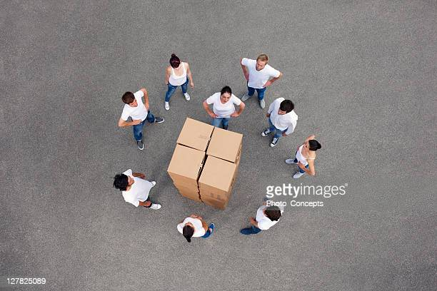 People stacking cardboard boxes