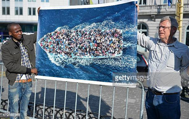 People stage a demonstration for the migrants who drowned of around 700 migrants off the Libyan coast on Sunday in Brussels Belgium on April 20 2015...
