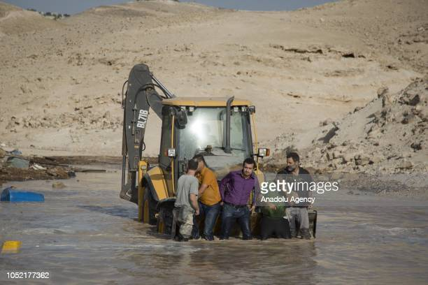 People stage a demonstration in support of the AlKhan AlAhmar Bedouin hamlet which is at the risk of demolition by Israeli authorities to block the...