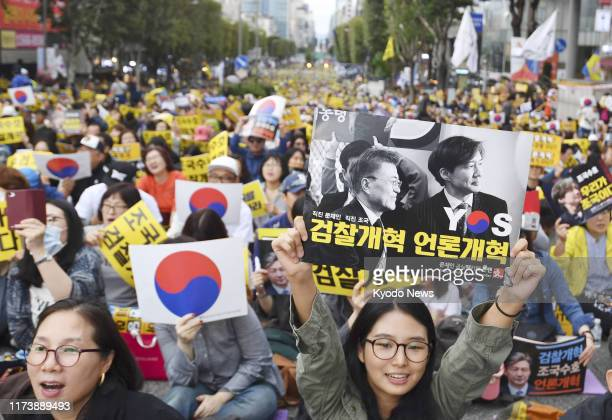People stage a largescale rally in Seoul on Oct 5 to support Justice Minister Cho Kuk and his drive to reform the prosecution amid a probe into...