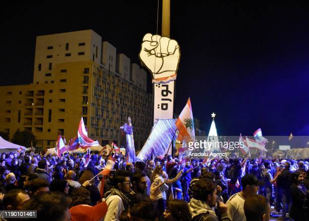 People stage a protest against Hassan Diab, former Education Minister-turned Prime Minister Hassad Diab tasked by President Michel Aoun to form a new...