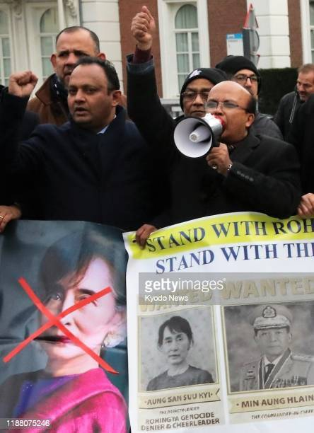 People stage a protest against Myanmar leader Aung San Suu Kyi outside the International Court of Justice in The Hague on the western coast of the...