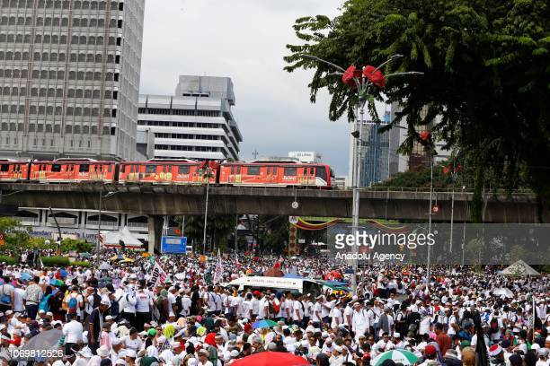 People stage a protest against the goverment to ratify the UN International Convention on the Elimination of All Forms of Racial Discrimination at...