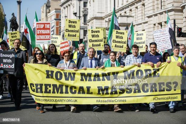 People stage a protest condemning Assad Regime's recent suspected chemical gas attack in Idlib on April 8 2017 in London England United Kingdom