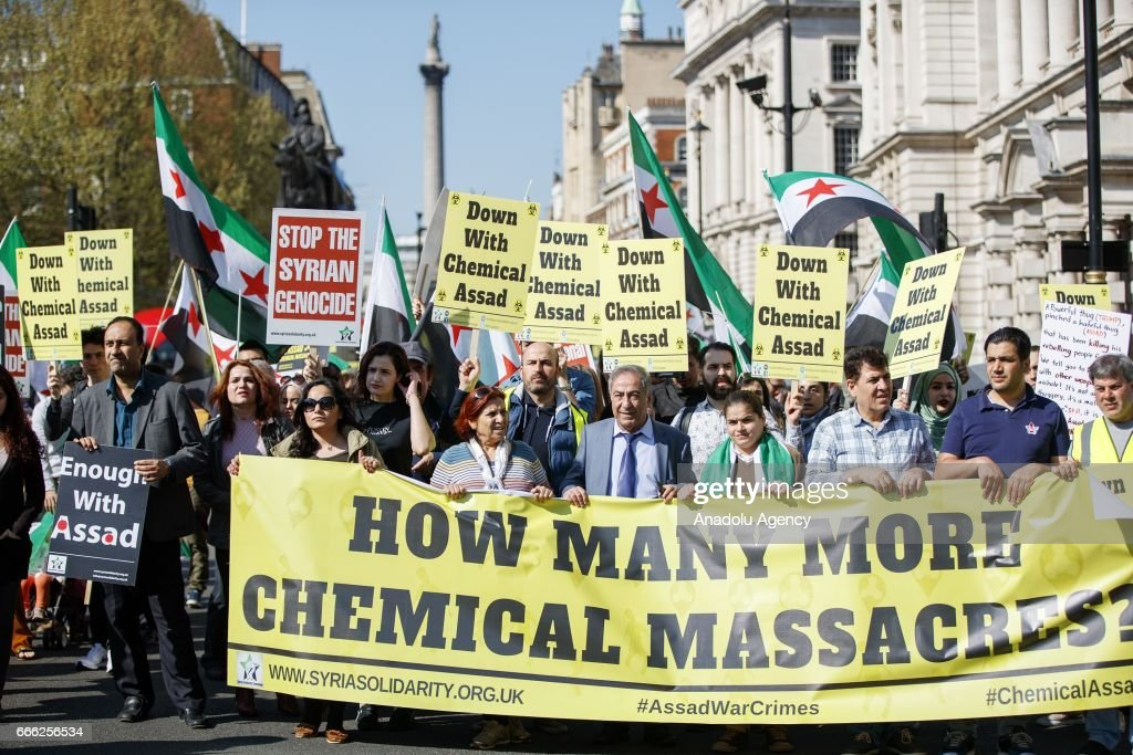 People stage a protest, condemning Assad Regime's recent suspected chemical gas attack in Idlib, on April 8, 2017 in London, England, United Kingdom.