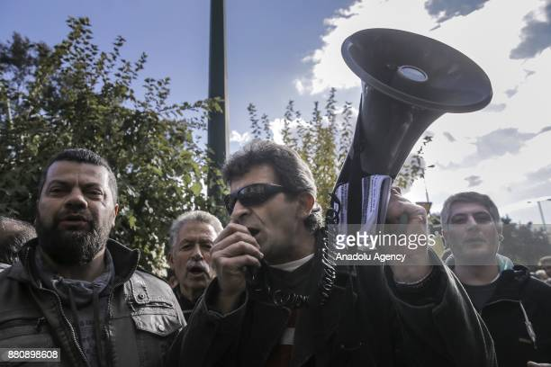 People stage a protest on privatization of Greece's stateowned utility company Public Power Corporation in front of the Greek Ministry of Energy...