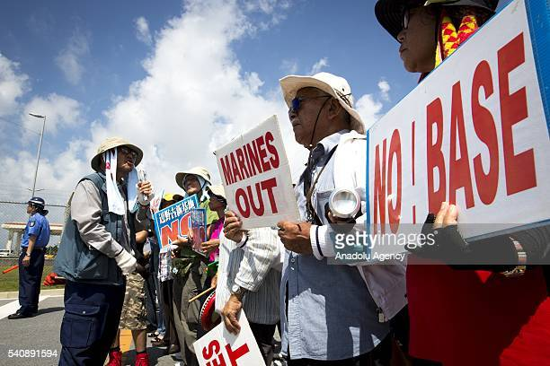 People stage a rally against past incident of rape of a Japanese woman and drunk driving in Okinawa over American military presence in Japan in front...