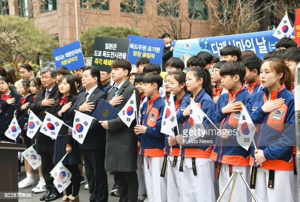 People stage a rally in front of the Japanese Embassy in Seoul on Feb 22 2018 to protest an annual event held by a local Japanese municipality to...
