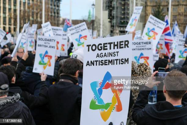People stage a Together Against Antisemitism rally in Parliament Square- PHOTOGRAPH BY Matthew Chattle / Barcroft Media