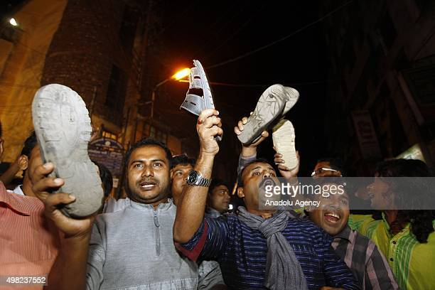 People stage against executions as they wait the Ambulances carrying dead bodies of Salahuddin Quader Chowdhury and Ali Ahsan Muhammad Mojaheed in...