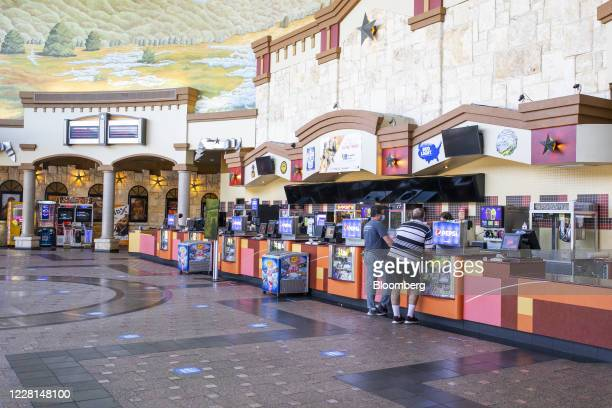 People stand a concessions counter at a Regal Cinemas theater in Austin, Texas, U.S., on Friday, Aug. 21, 2020. Regal Cinemas is opening 190 of its...