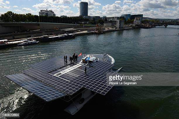 People stand above the Turanor PlanetSolar the largest solar vessel in the world powered exclusively by the sun departs to Lorient on September 15...