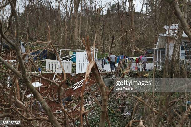 People stand among their home that was damaged when Hurricane Maria passed through the area on September 24 2017 in Progreso Barrio Pulguillas Puerto...