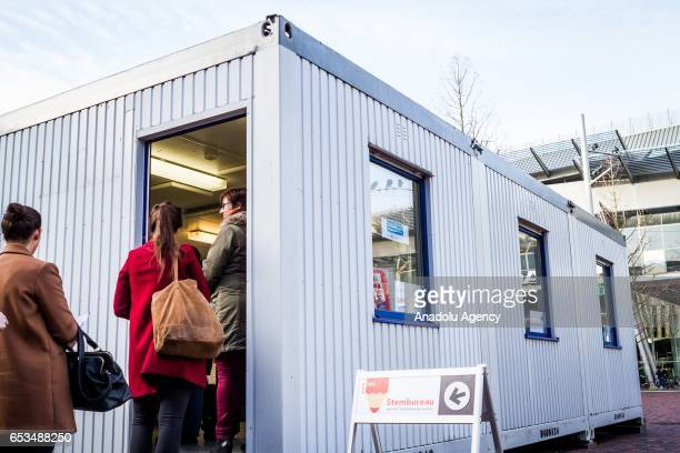 People stand and line up to vote for the second Chamber elections outside of the Amsterdam Bijlmer Arena Stadium in Amsterdam Netherlands on March 15...