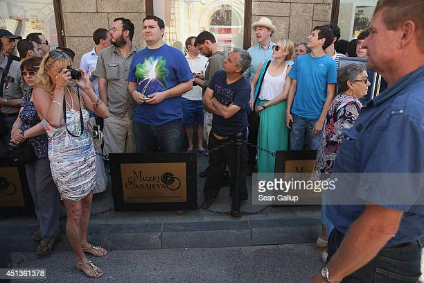People stand at 1049am at the spot where exactly 100 years before Serbian secessionist Gavrilo Princip fatally shot Austrian Archduke Franz Ferdinand...