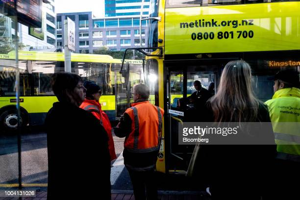 People stand at a bus stop in Wellington New Zealand on Wednesday July 18 2018 New Zealand inflation picked up in the second quarter amid higher fuel...