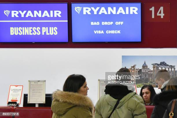 People stand at a checkin desk Ryanair on December 15 2017 at Rome's Ciampino airport Ryanair has invited pilot unions across Europe for talks on...