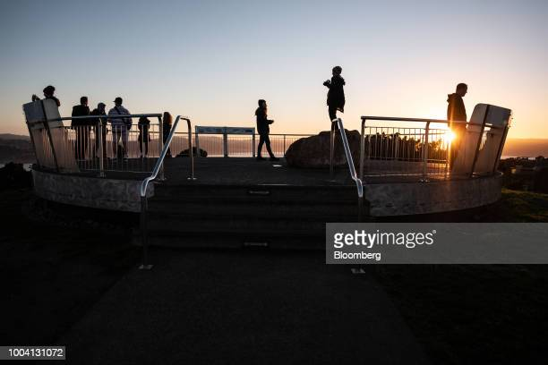 People stand at an observation deck at Mount Victoria Lookout at dawn in Wellington New Zealand on Wednesday July 18 2018 New...
