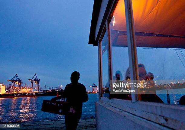 People stand at the bar and restaurant Strandperle at the beach Ovelgonne on the river Elbe on September 16 2011 in Hamburg GermanyThe beach has a...