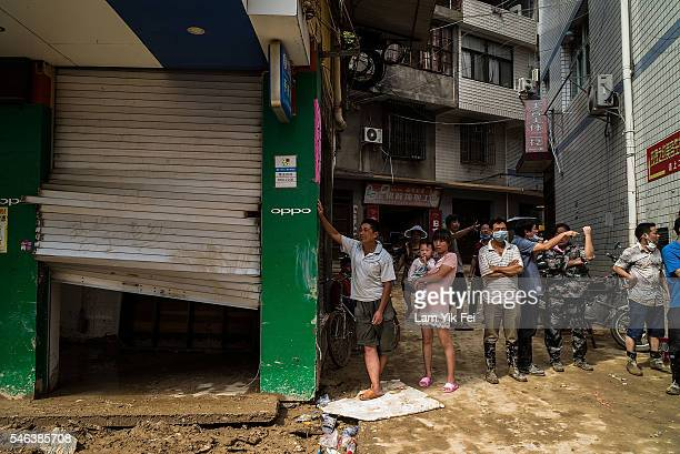 People stand at the damaged shopping street in the aftermath on July 12 2016 in Fuijan China Typhoon Nepartak hit China's coastal southeastern Fujian...