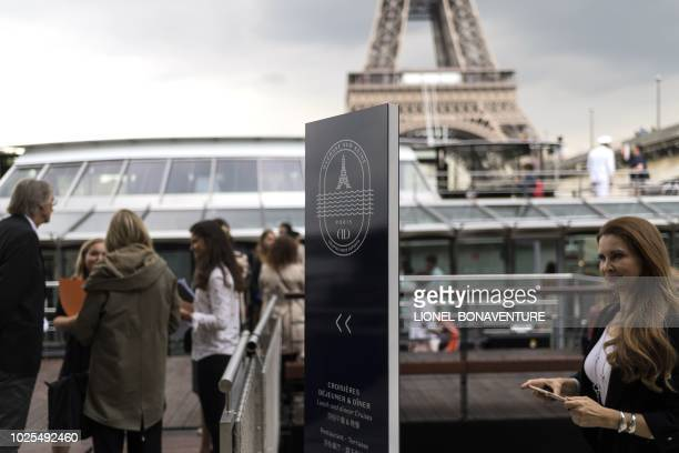 People stand at the entrance of French chef Alain Ducasse's new boat restaurant the 'Ducasse sur Seine' on August 30 2018 in Paris Still smarting...