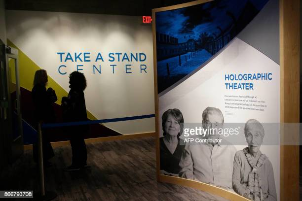 People stand at the entrance of the Take A Stand Center at the Illinois Holocaust Museum Education Center on October 26 2017 in Skokie Illinois / AFP...