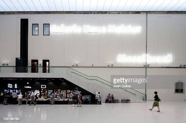 People stand at the gift shop in the main hall at the Albertinum museum on August 1 2010 in Dresden Germany The Albertinum which exhibits paintings...