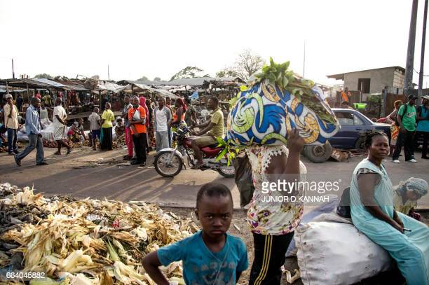 People stand at the market in Kinshasa on April 3, 2017 during a general strike called by the opposition. A general strike called by the opposition...