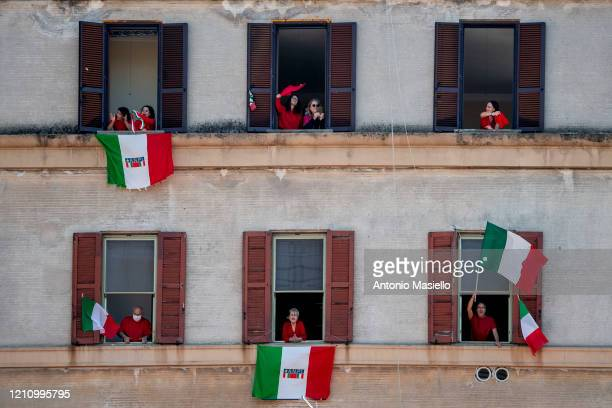 "People stand at their windows and balconies while to take part in a 'Liberation Day' flashmob and sing the Italian partizan song ""Bella Ciao"" at..."