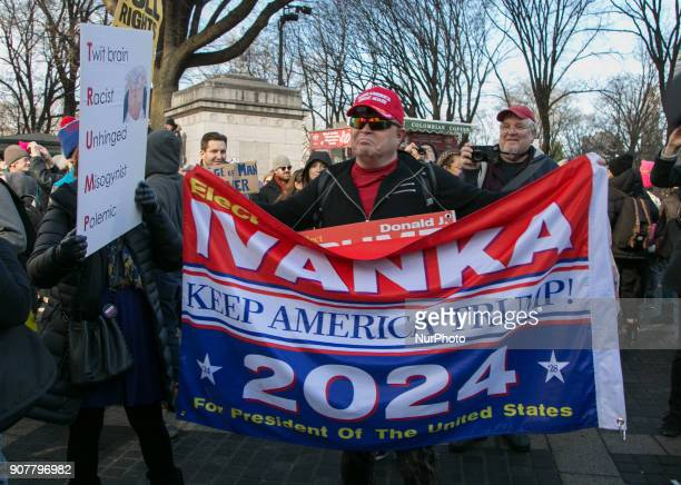 People stand behind a banner with words 'Ivanka Keep America Trump' during the Second Annual Womens March on January 20 2018 near Central Park in New...
