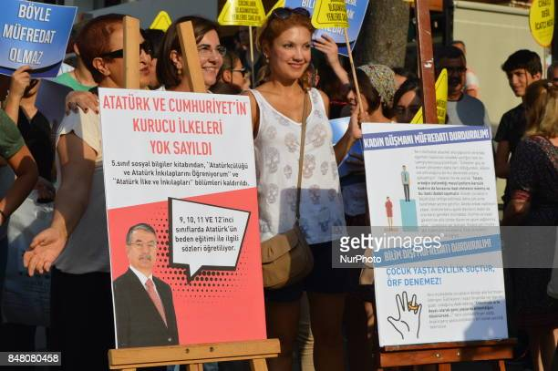 People stand behind boards as they protest against the Turkish government's new education policies in Ankara Turkey on September 16 2017 The Turkish...