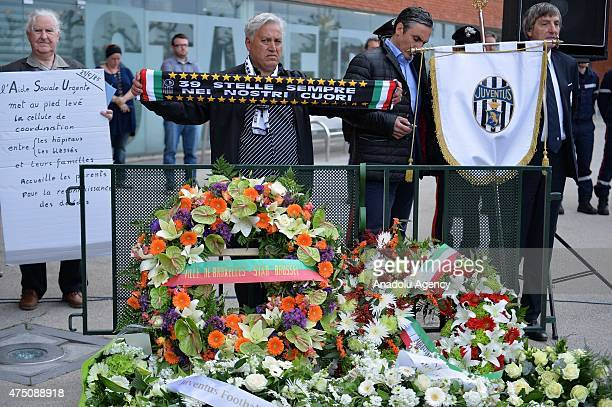 People stand behind the wreaths during a ceremony marking the 30th anniversary of the tragedy at the stadium renamed King Baudouin Stadium in...