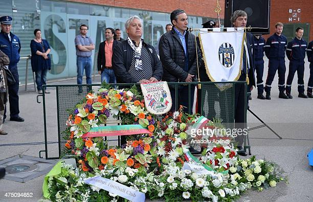 People stand behind the wreaths during a ceremony marking the 30th anniversary of the tragedy at the stadium, renamed King Baudouin Stadium, in...