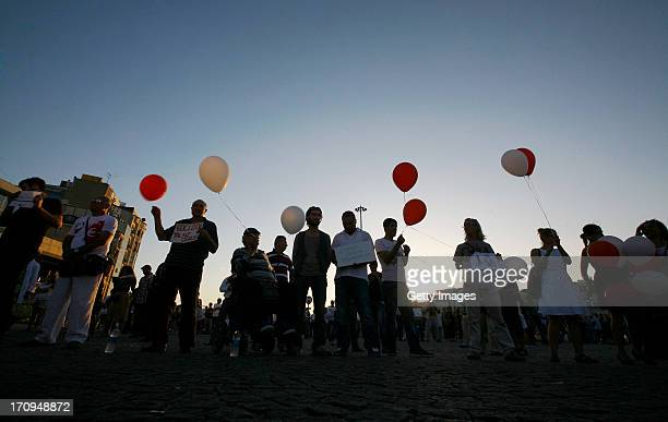 People stand during a silent protest at Taksim Square on June 20 2013 in Istanbul Turkey Performance artist Erdem Gunduz nicknamed The Standing Man...
