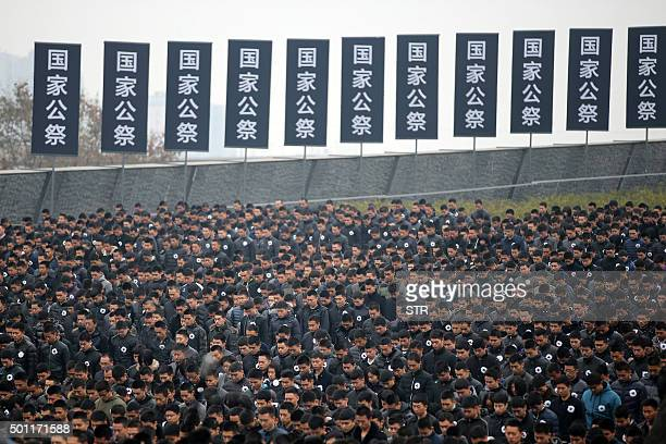 People stand for a moment of silence as they gather in front of the Nanjing Massacre Memorial Hall on the second annual national day of remembrance...