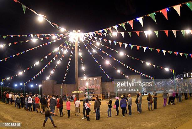 People stand in a cue for attractions during the Halloween Harvest Festival at Pierce Farm on October 30 2012 in Woodland Hills California AFP...