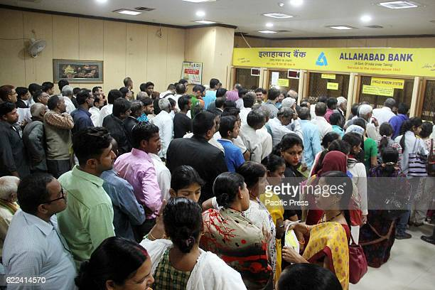 People stand in a long queue to exchange Rupees 500 and 1000 notes PM Narendra Modi ordered ban Rupees 500 and 1000 notes as NDA Government fights...