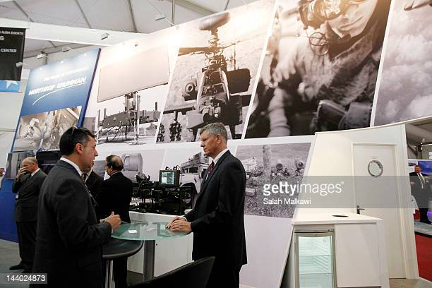 People stand in a Northrop Grumman display during the 9th Special Operations Forces Exhibition and Conference May 08 2012 in Amman Jordan SOFEX...