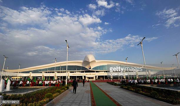 People stand in front of a building of a new five-floor international airport in Ashgabat on September 17, 2016. Tightly-controlled Turkmenistan's...