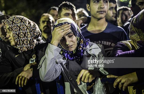 People stand in front of a hospital as they wait for news of relatives on May 14 2014 in Soma At least 201 people were killed and hundreds more...