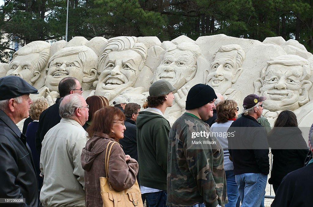 People stand in front of a sand sculpture depicting Republican presidential candiates (L-R) Mitt Romney, Newt Gingrich, former candidate Jon Huntsman, Rick Perry, Rick Santorum and Ron Paul, in front of the Myrtle Beach Convention Center, on January 16, 2012 in Myrtle Beach, South Carolina. Later tonight all the remaining Republican candidates will participate in a 90 minute debate.